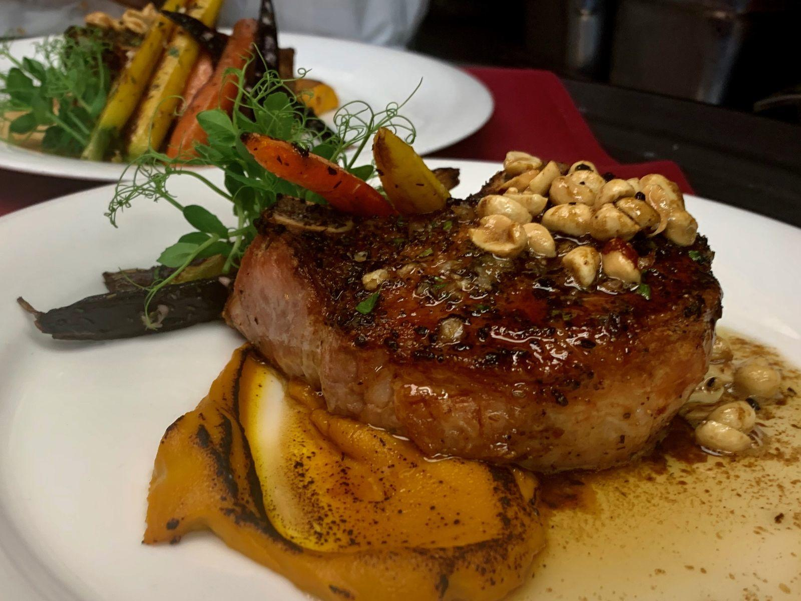 delicious steak dish with side of vegetables