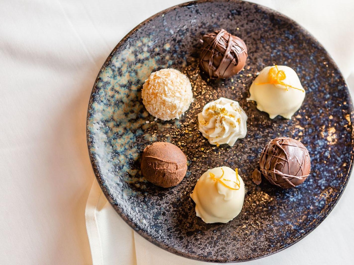 assorted which and dark chocolate desserts