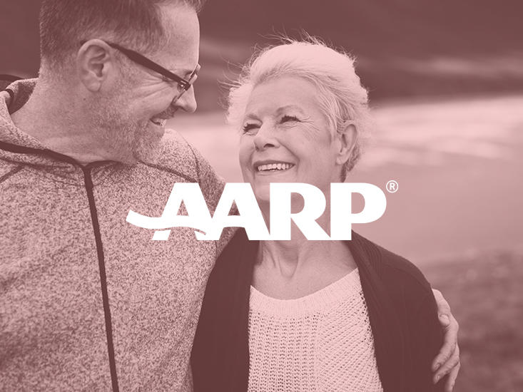 older couple hugging side by side with AARP logo overlay