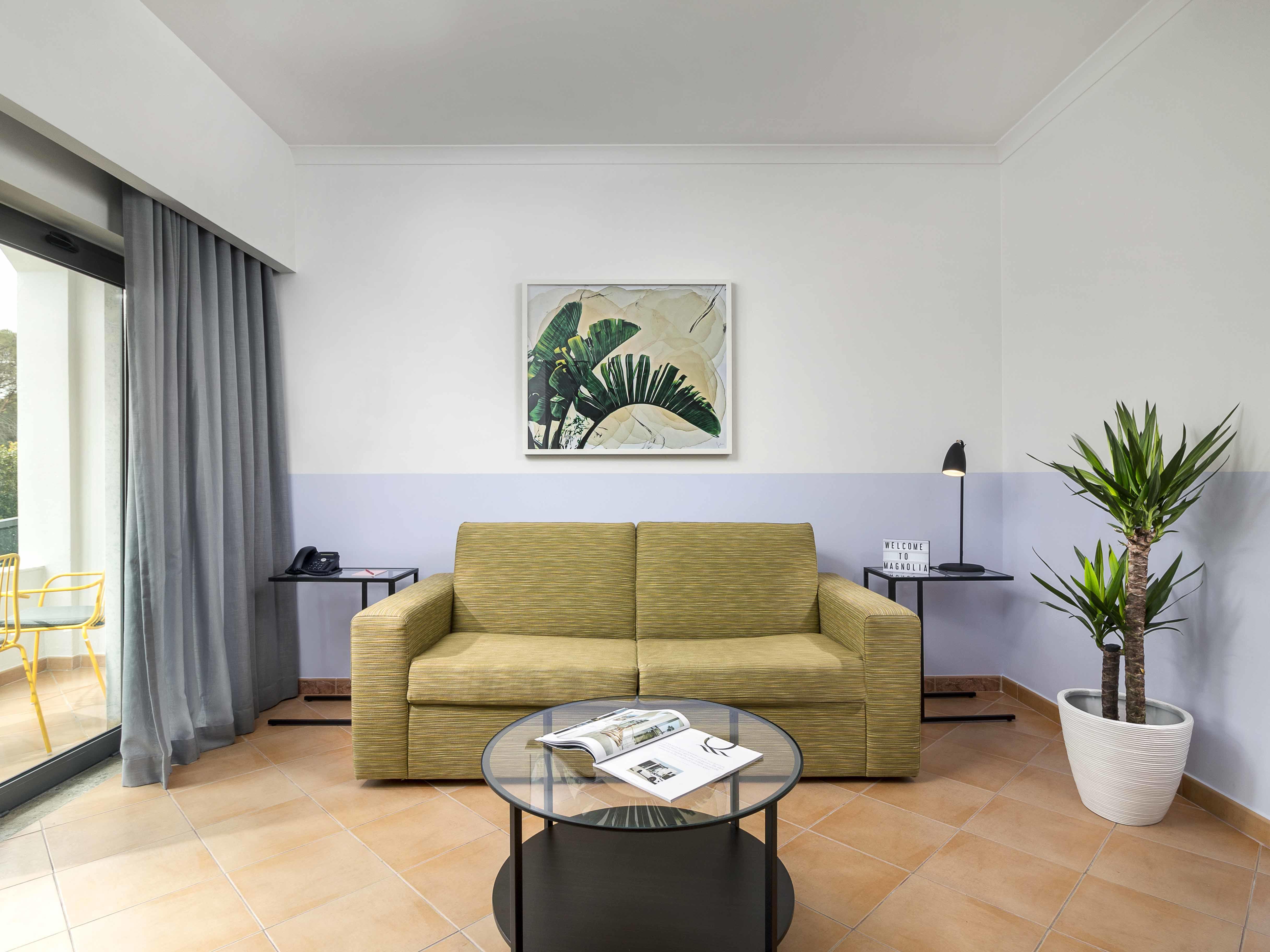 Sofa in the room - The Magnolia Hotel