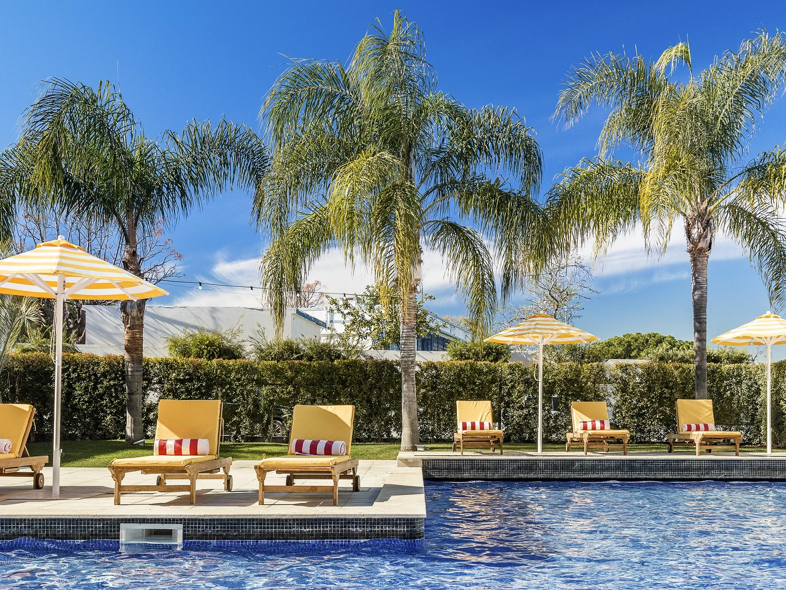 Exterior Pool side -The Magnolia Hotel