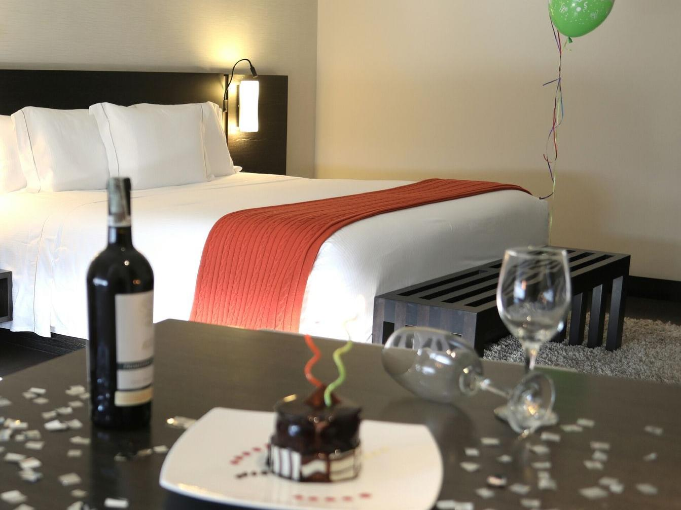birthday celebration with cake and wine in room