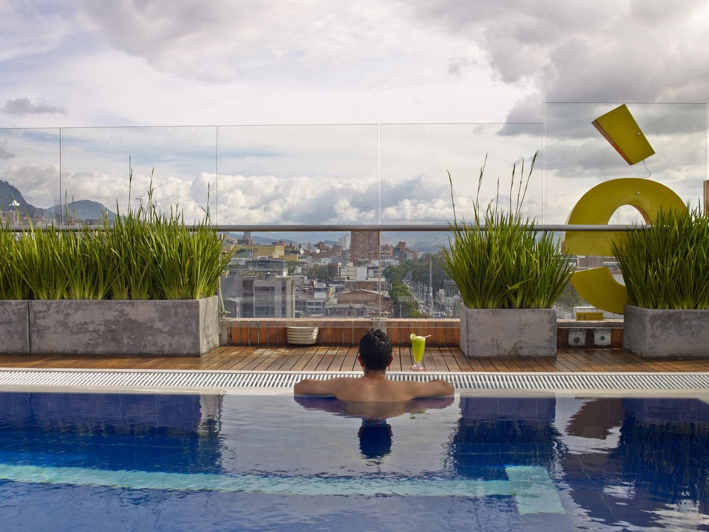 man overlooking view in pool