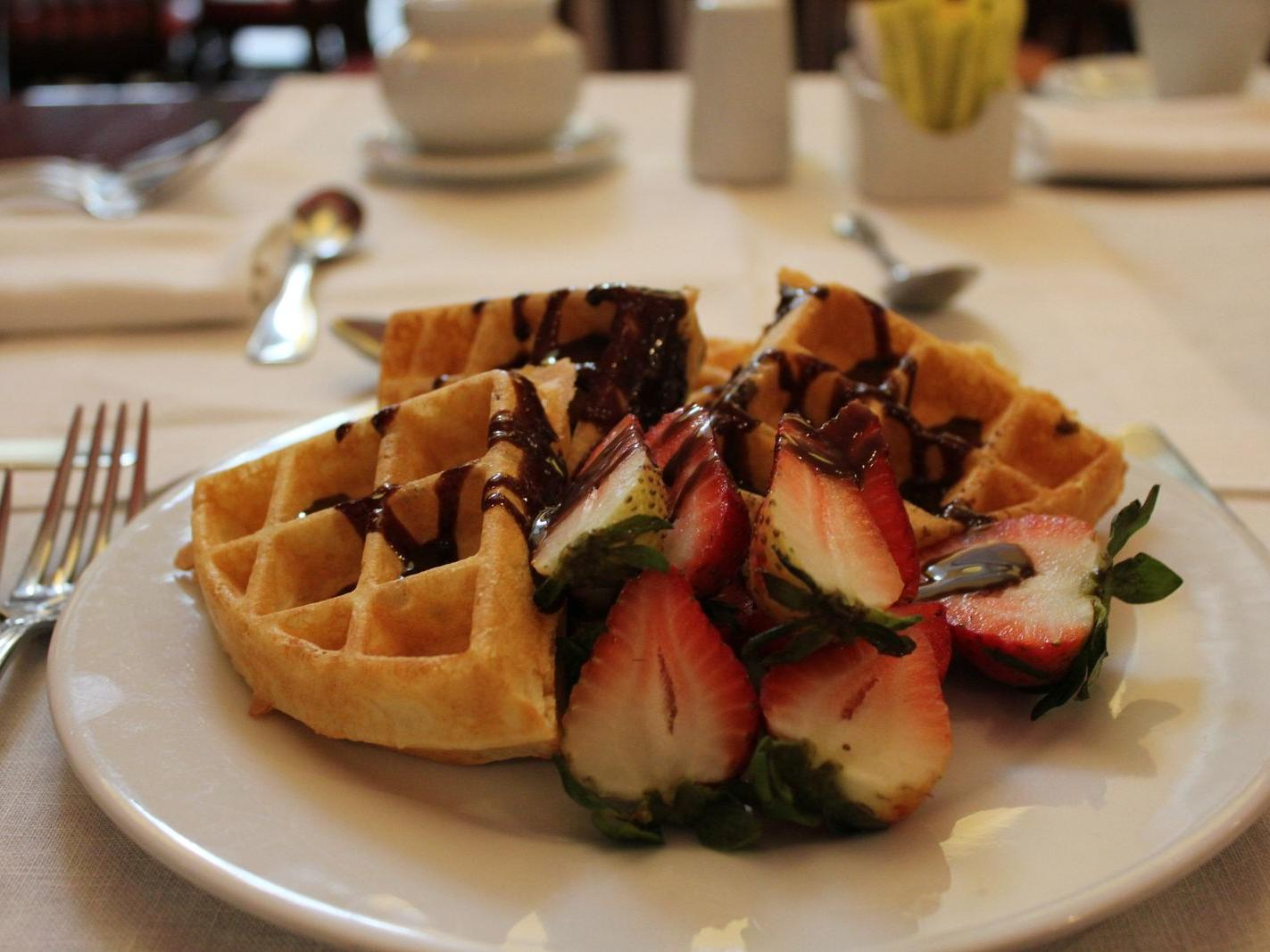 waffles and strawberries drizzled with chocolate