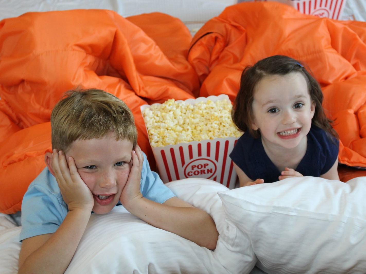 two children eating popcorn