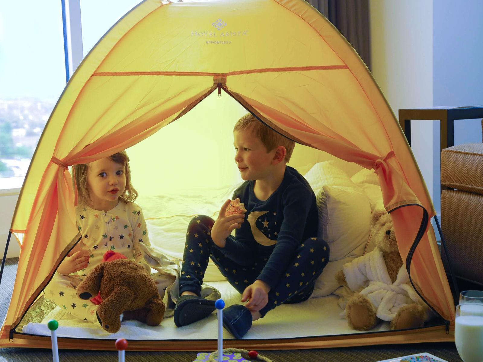 two children in a small tent