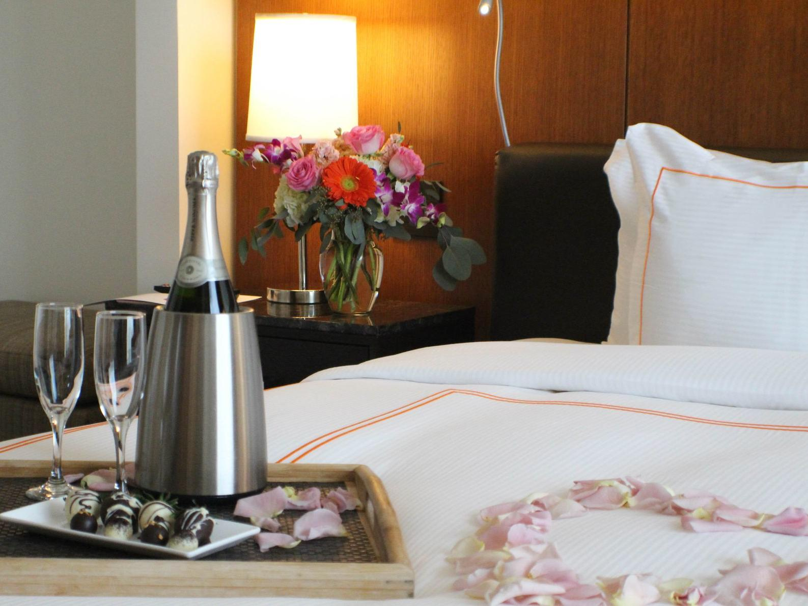 chilled champagne on a hotel bed