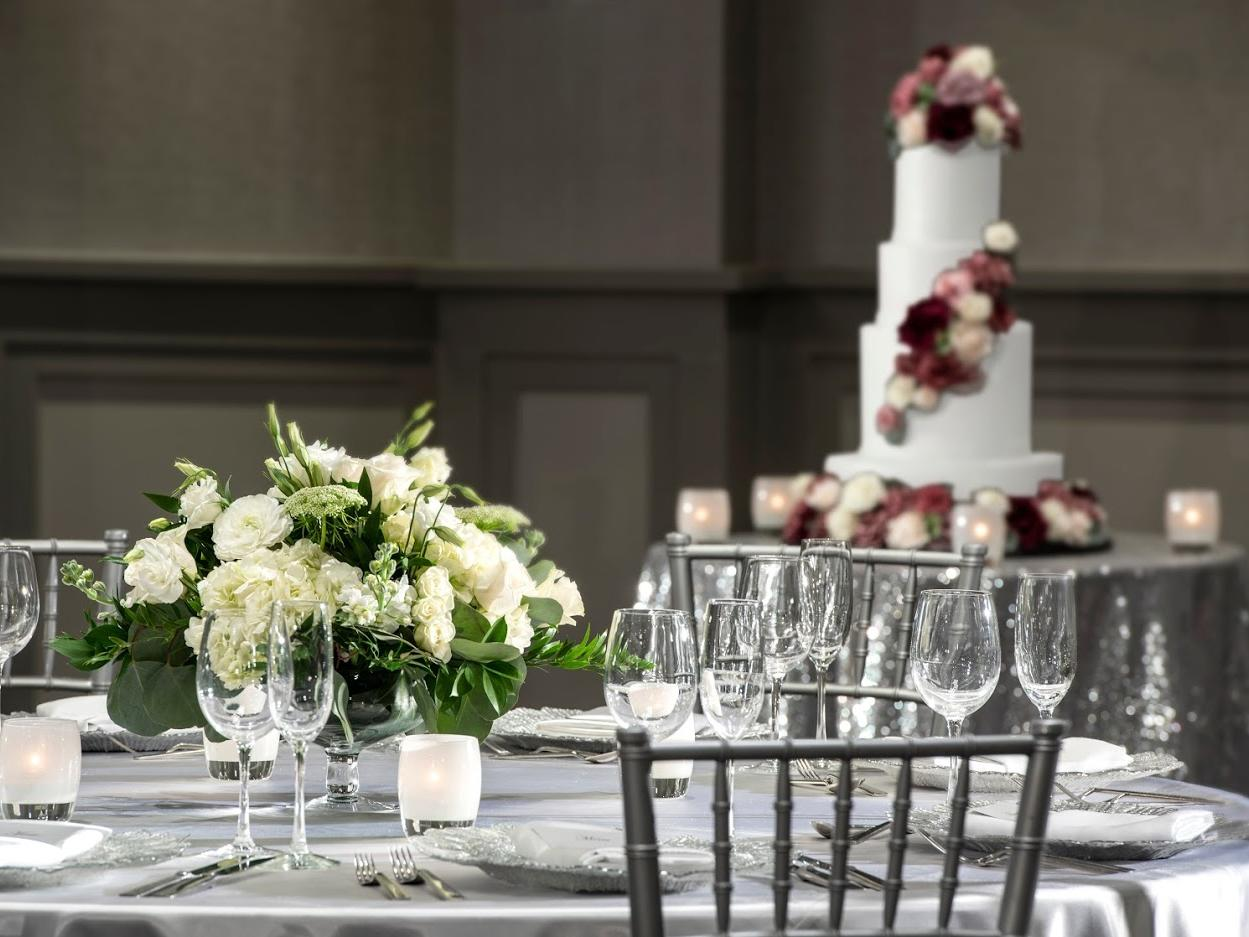 dining table next to wedding cake table