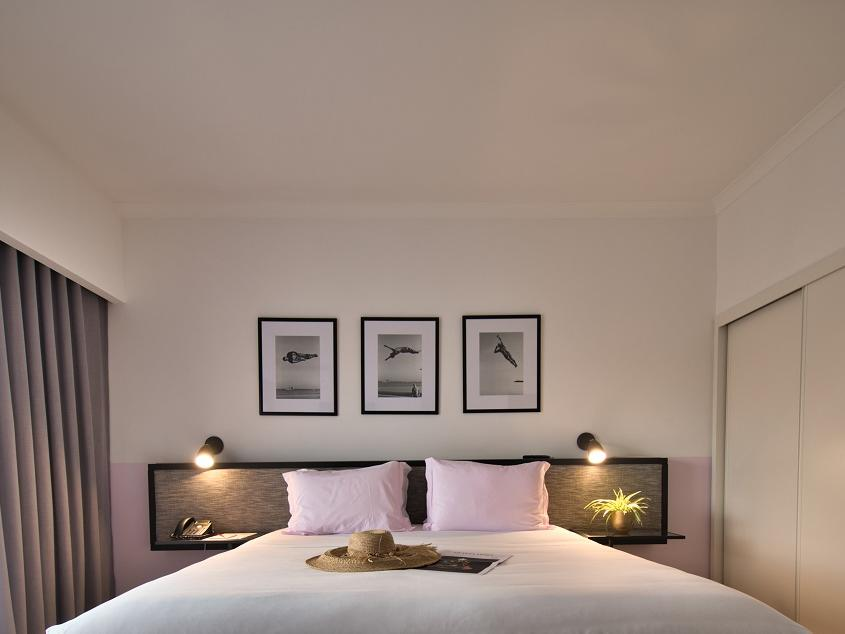 Bedroom with wall pictures - The Magnolia Hotel