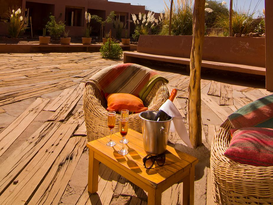 calm outdoor wine & lounge area at NOI Casa Atacama Hotel