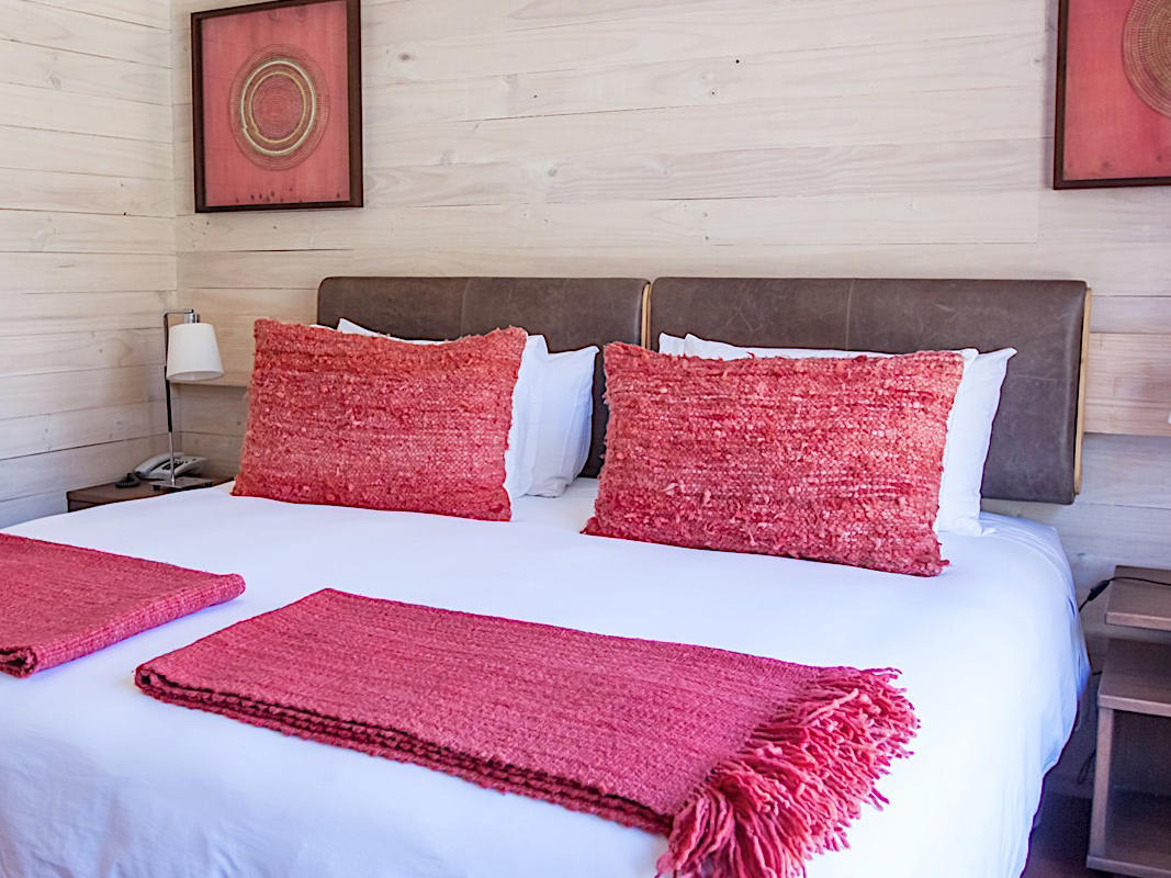 deluxe room bedroom with King Bed at NOI Puma Lodge Hotel