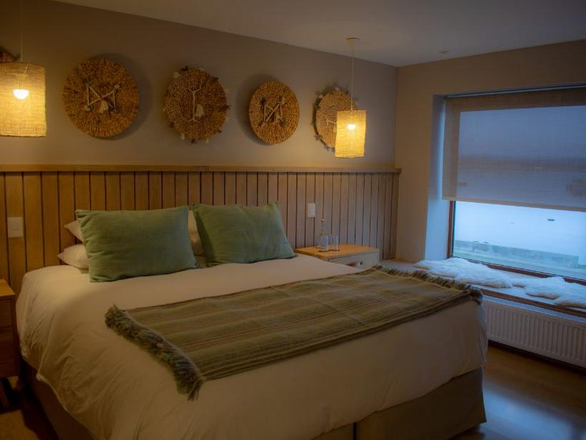 Bedroom of NOI Suite with a kingbed at NOI Indigo Patagonia