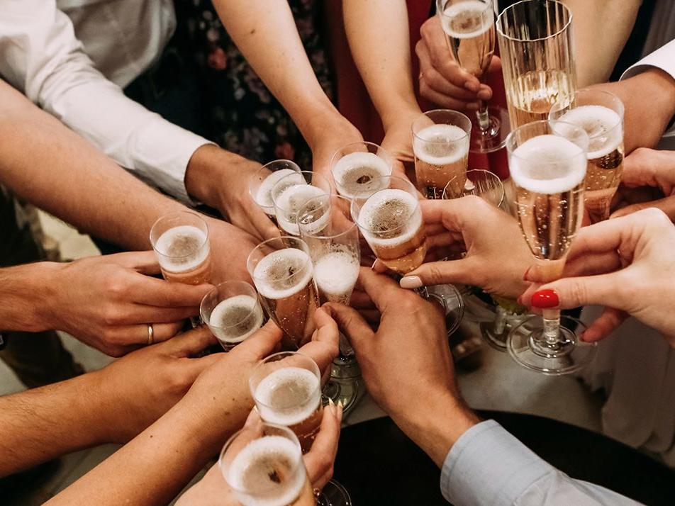 Group of hands clinking glases of champagne
