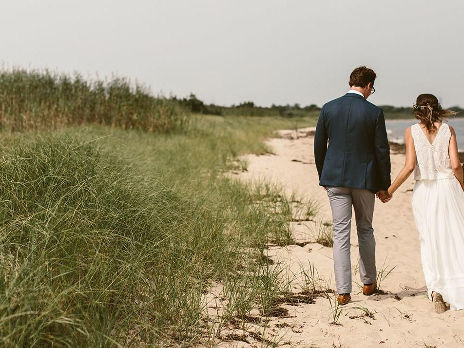 Wedding couple walking on beach