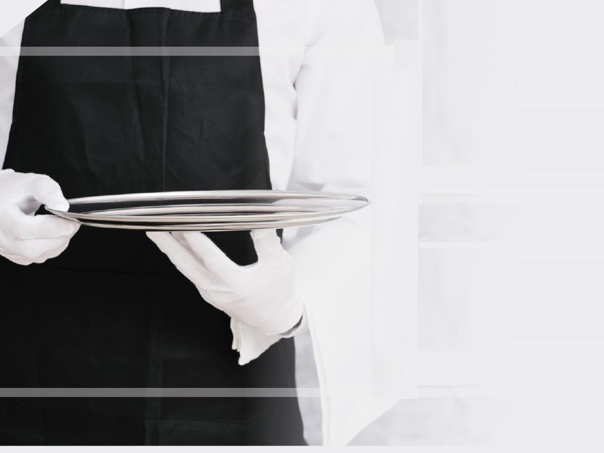 A waiter holding a tray