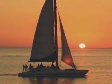 Sailboat at sunset in the sea near Shephard's Beach Resort
