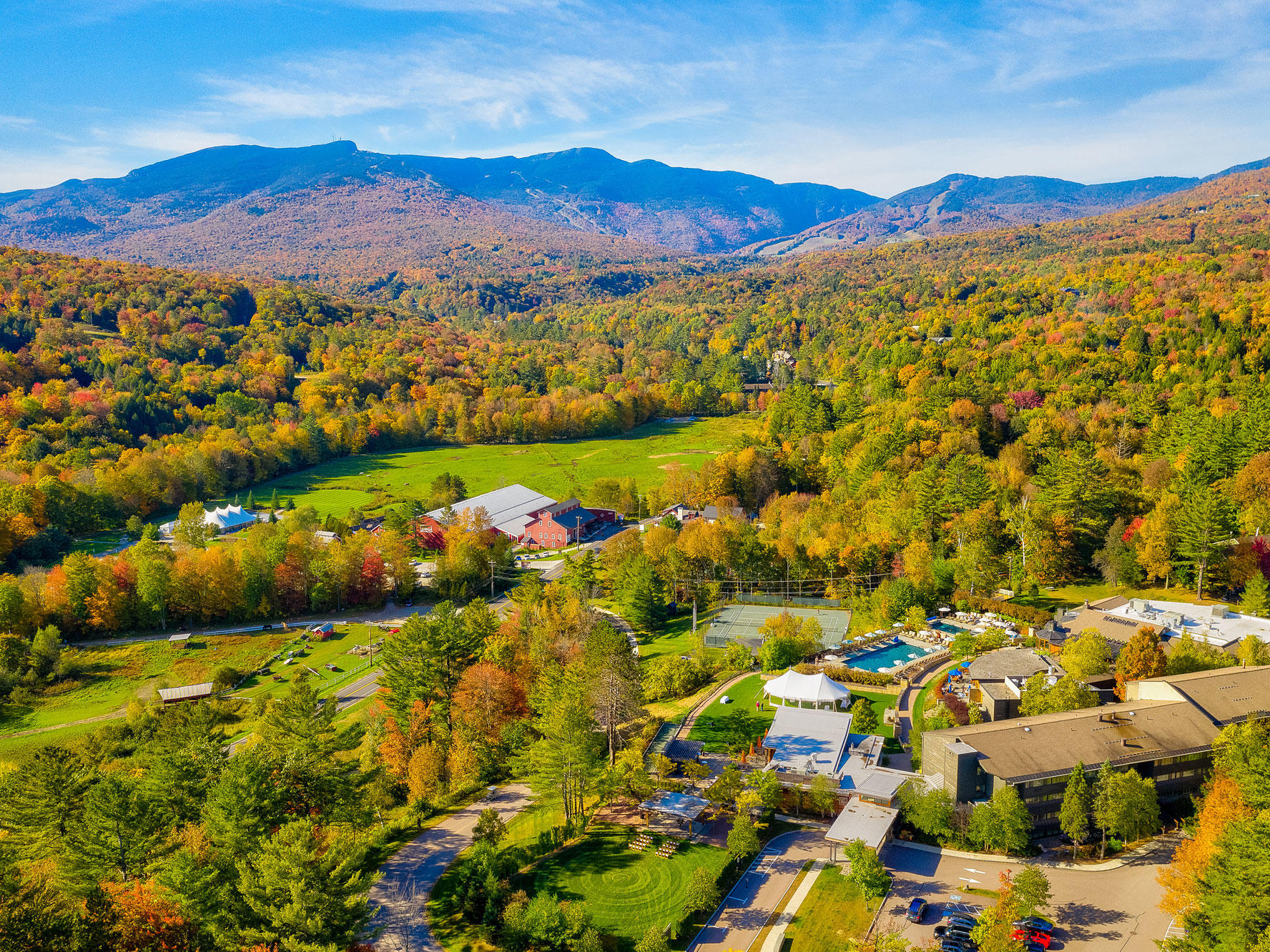 aerial photo of topnotch resort and green mountains in autumn
