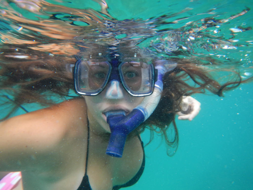 Woman snorkeling in the sea at Tamarind Reef Resort