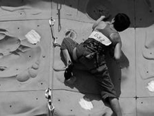 Black and white photo of rock climber
