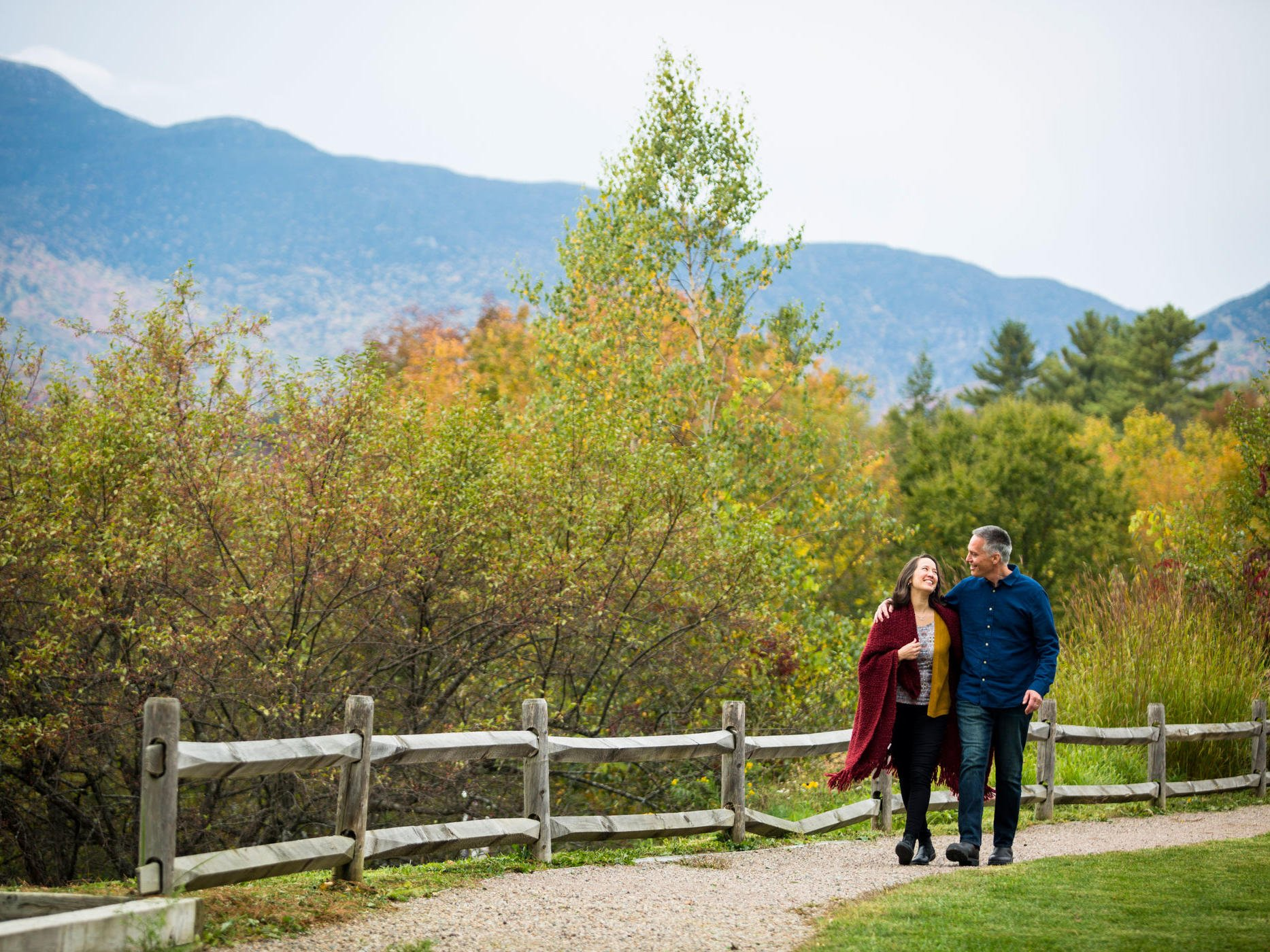 couple walking with fall foliage