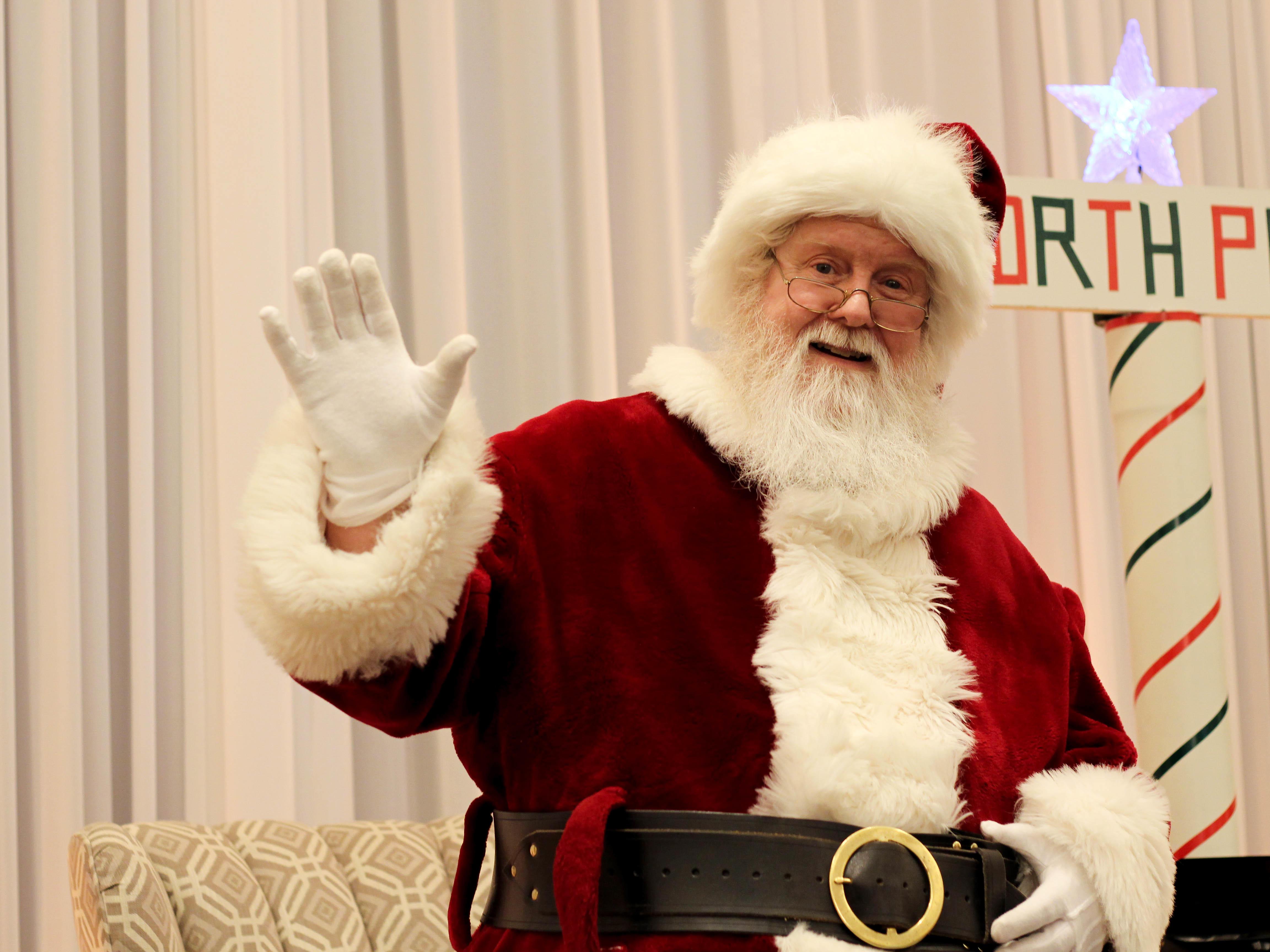 santa claus waving his hand
