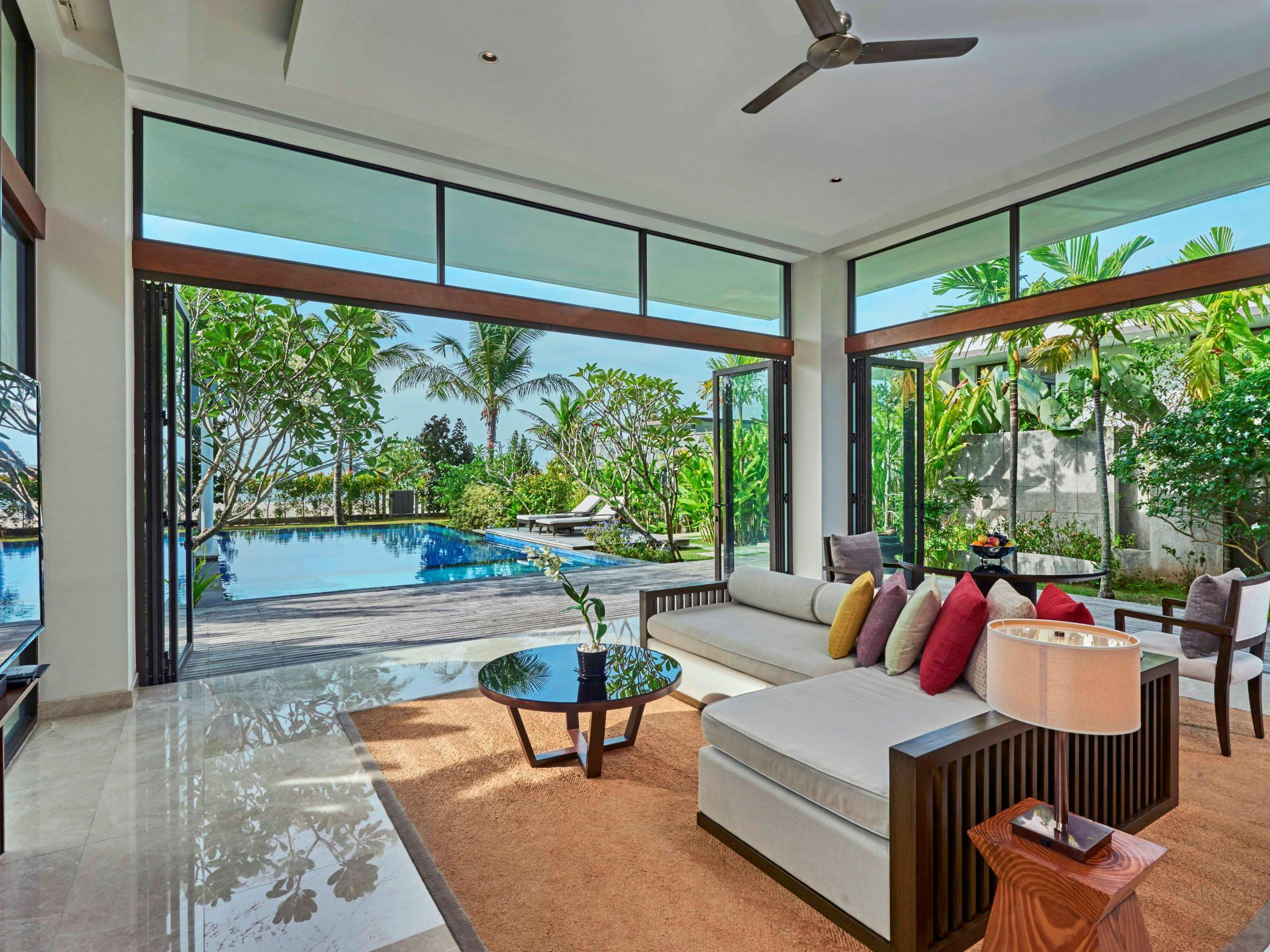 Living room and exterior pool view