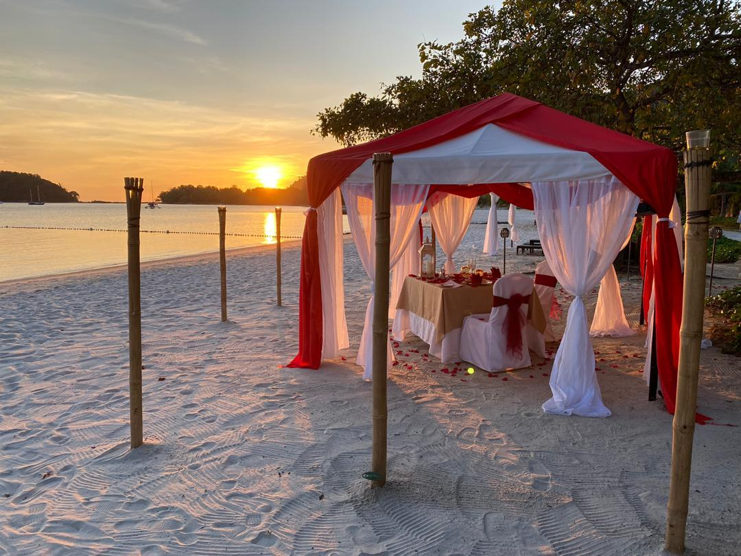 Romantic meal at the beach with the sunset
