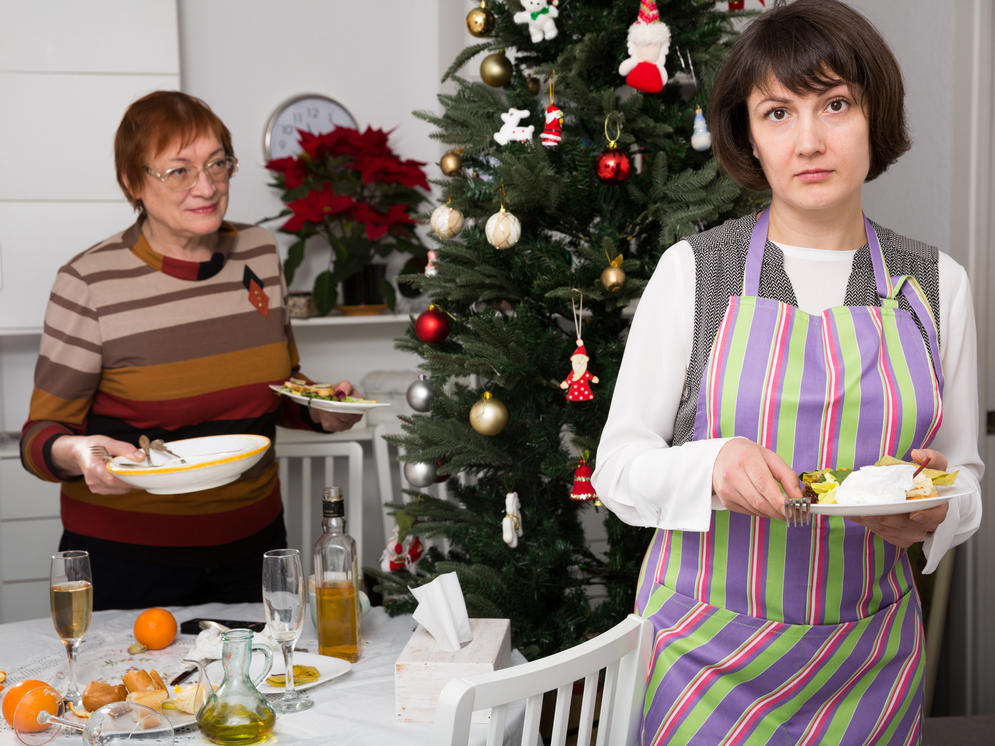 a mom and daughter holding dinner plates