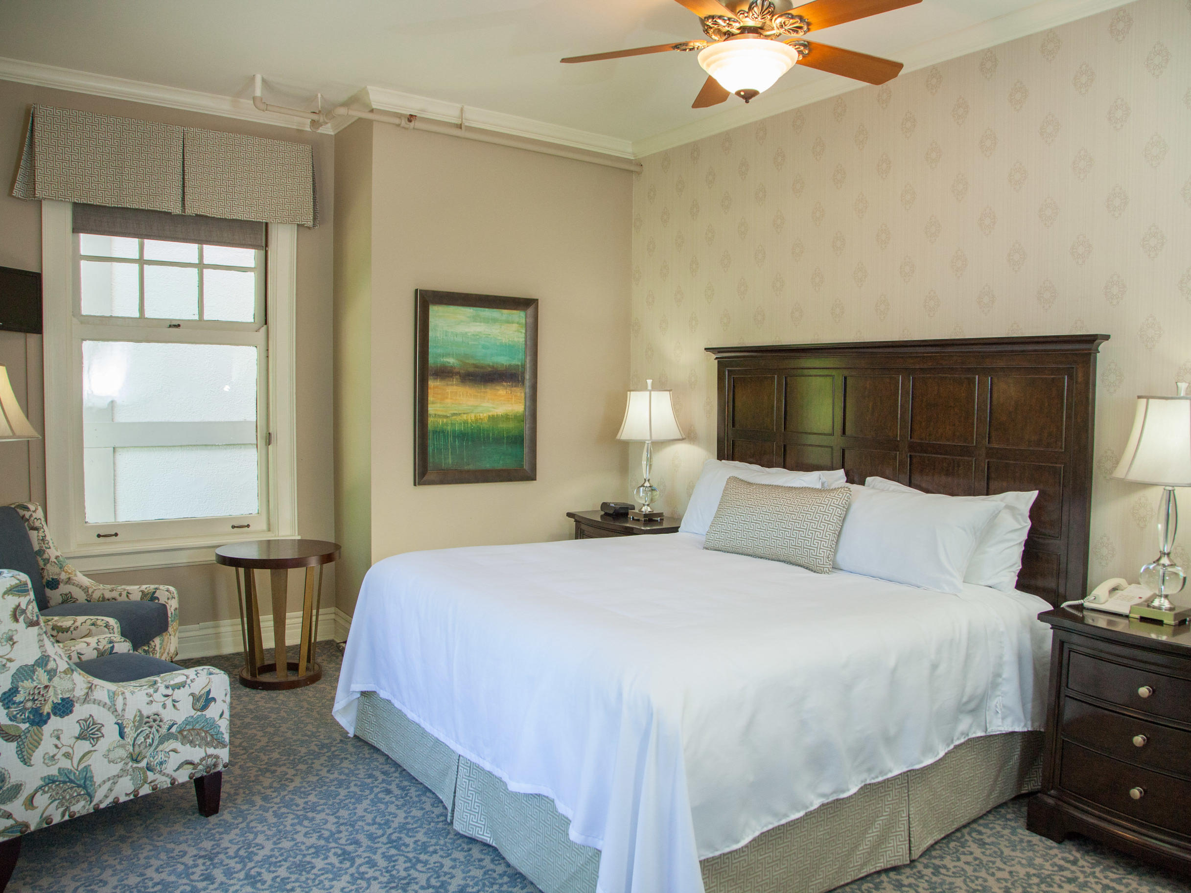 Mansion guestroom with queen bed