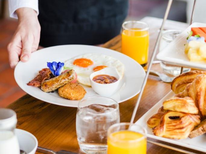 Breakfast with bread rolls and fruit juice at Artyzen Grand Lapa Hotel Macau
