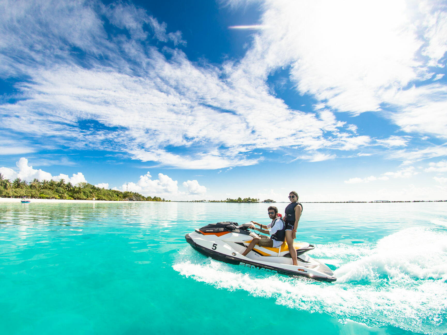 couple on jet ski in water