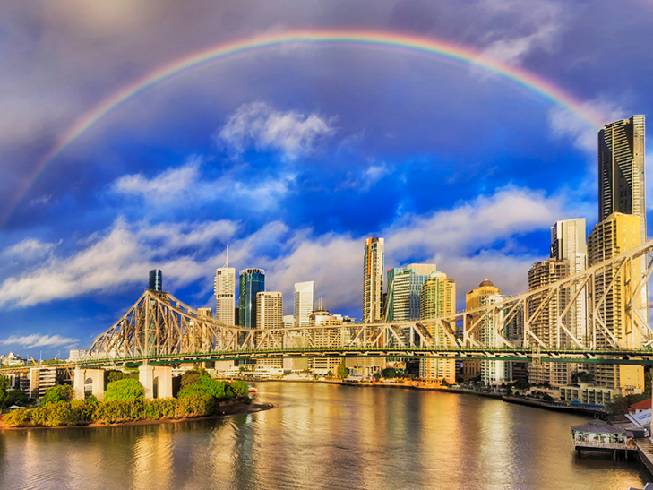 Brisbane and the Story Bridge on a fine day with a rainbow - discover more of Brisbane with this package