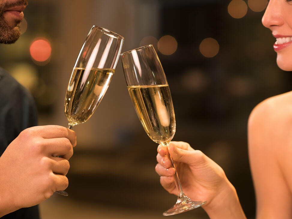 A couple is having a Romantic Sparkling Wine at Monte Carlo Inn Barrie Suites