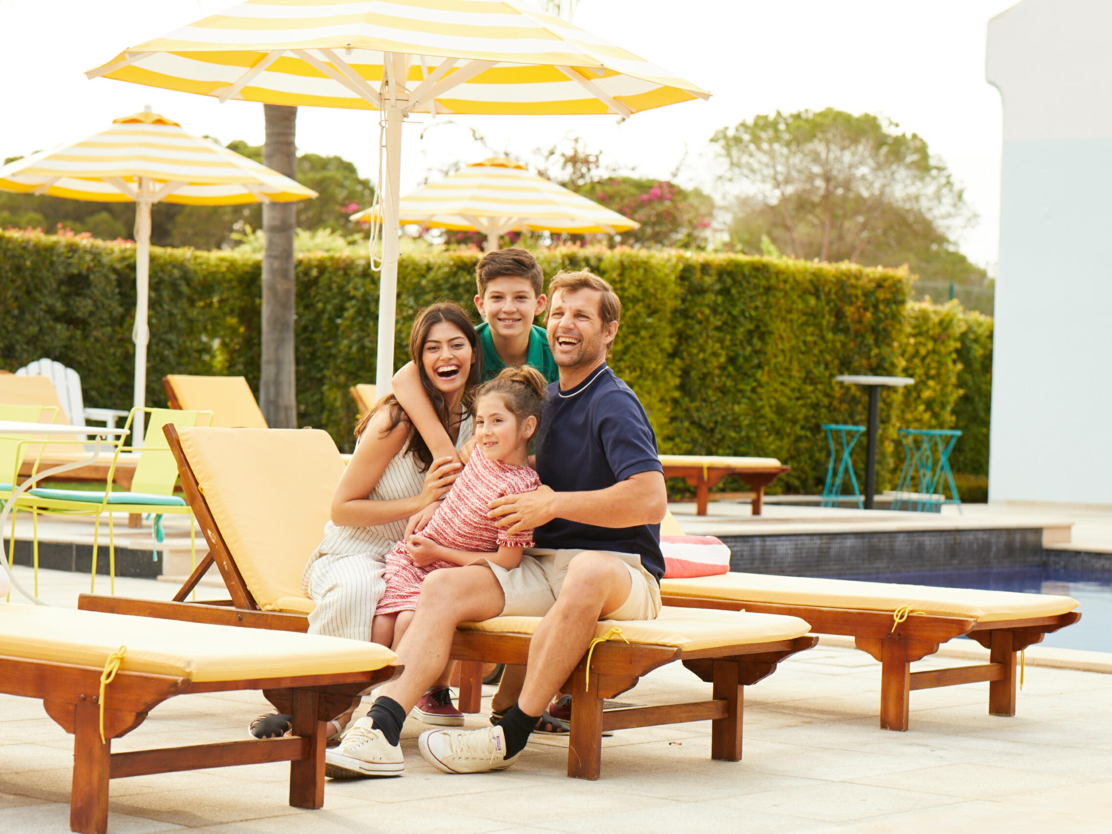 Happy Family at pool side -The Magnolia Hotel