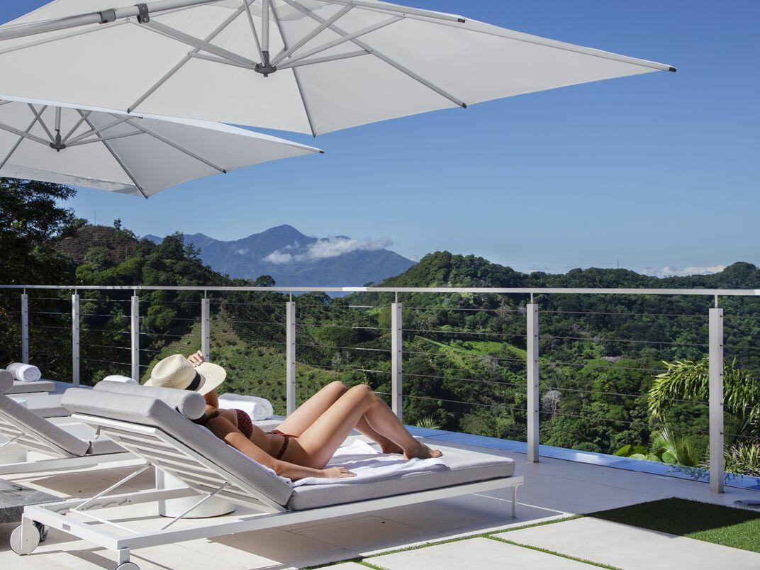 woman sun bathing on lounge chair