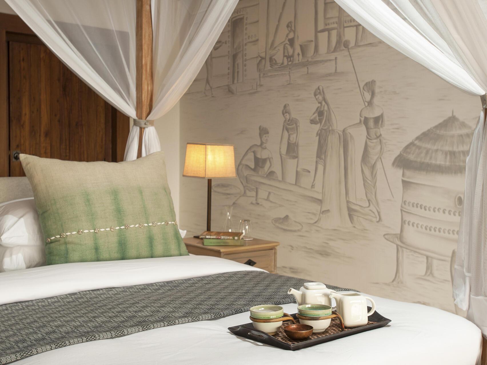 Tea tray on the bed  at Meghauli Serai