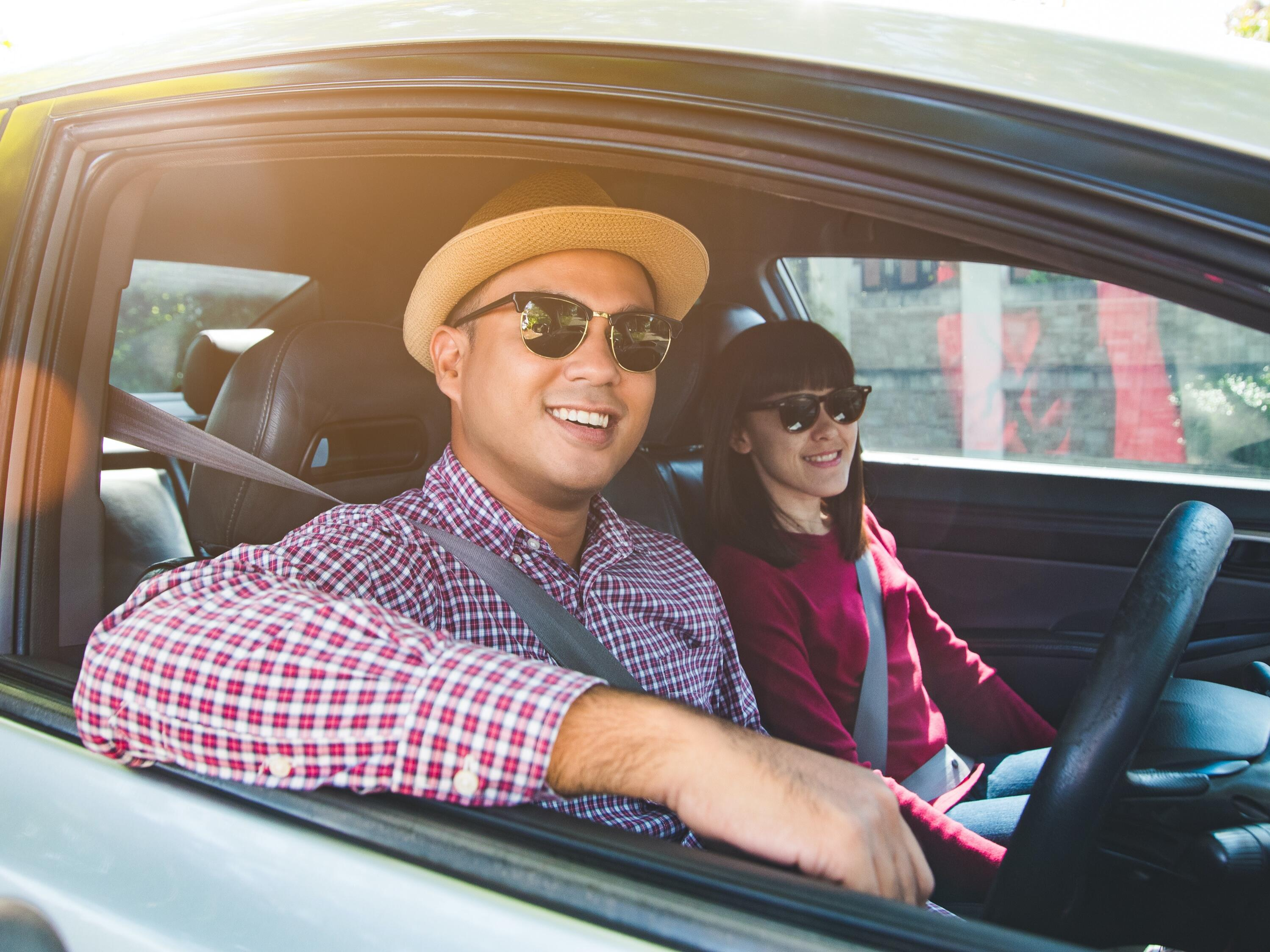 A couple travelling in a vehicle