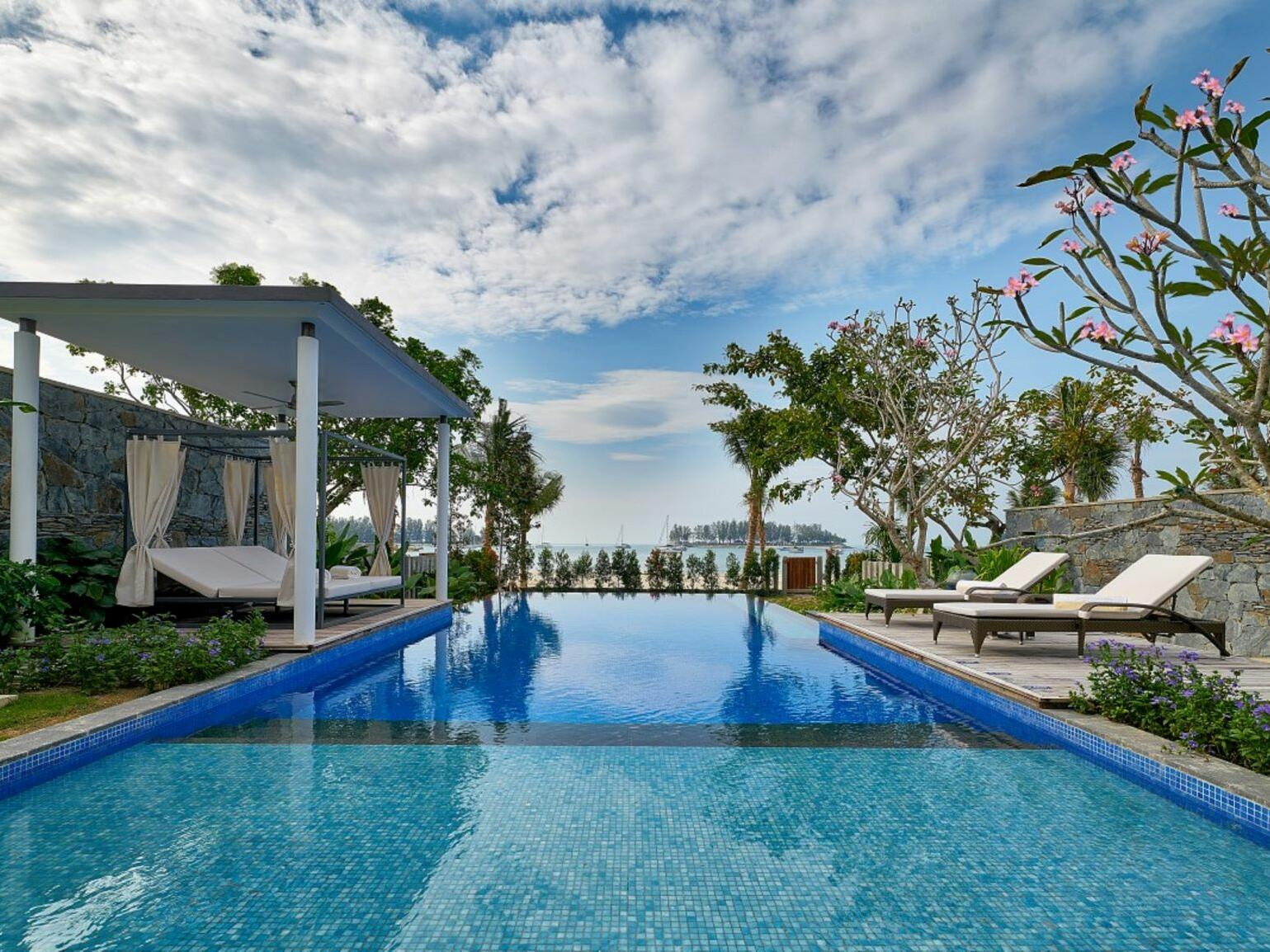 Swimming pool with sunbeds at The Danna Langkawi