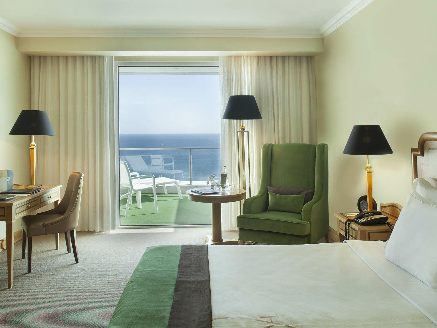 A bedroom with a beautiful view at Hotel Cascais Miragem