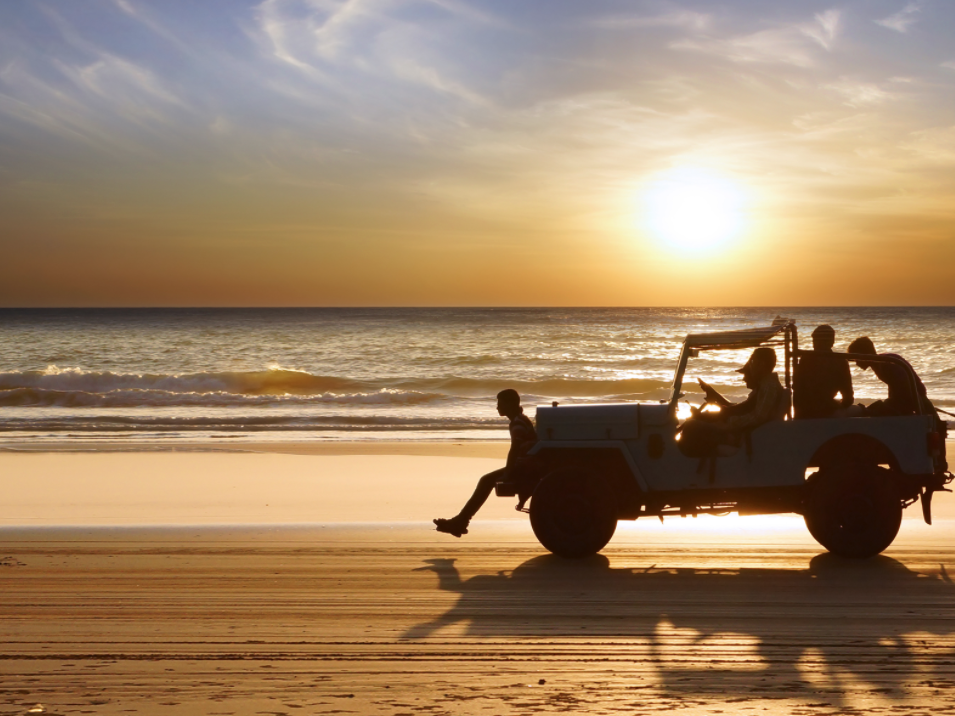 a group riding in a jeep on daytona beach during sunrise