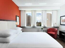 doubletree by hilton san juan guestroom with bed and desk