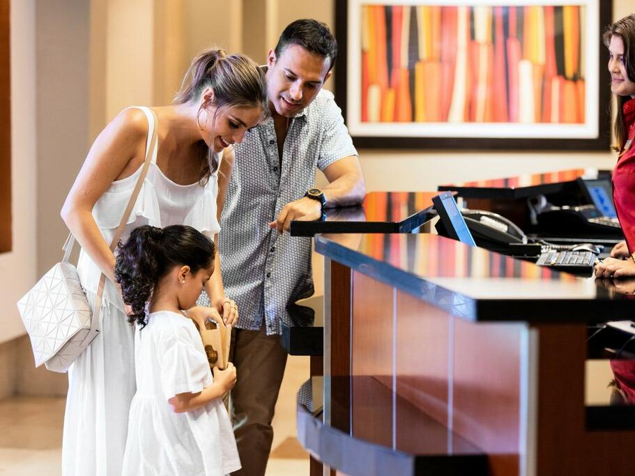 family checking in to hotel