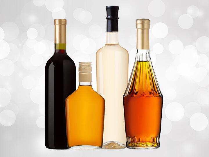 Various Bottles of Unbranded Liquor Bottles Together