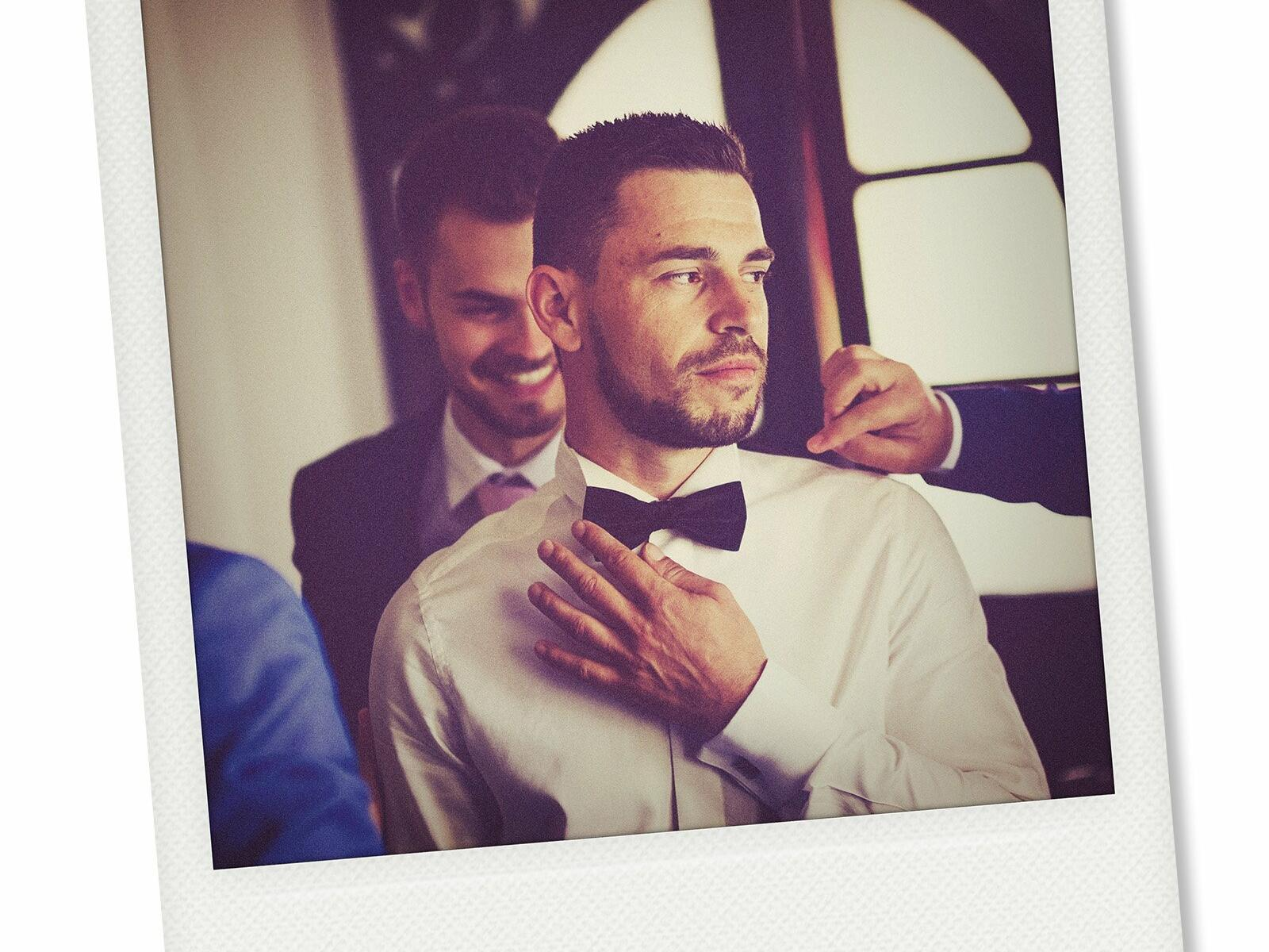 Photo Booth Image of groom getting ready at Dream Midtown NYC