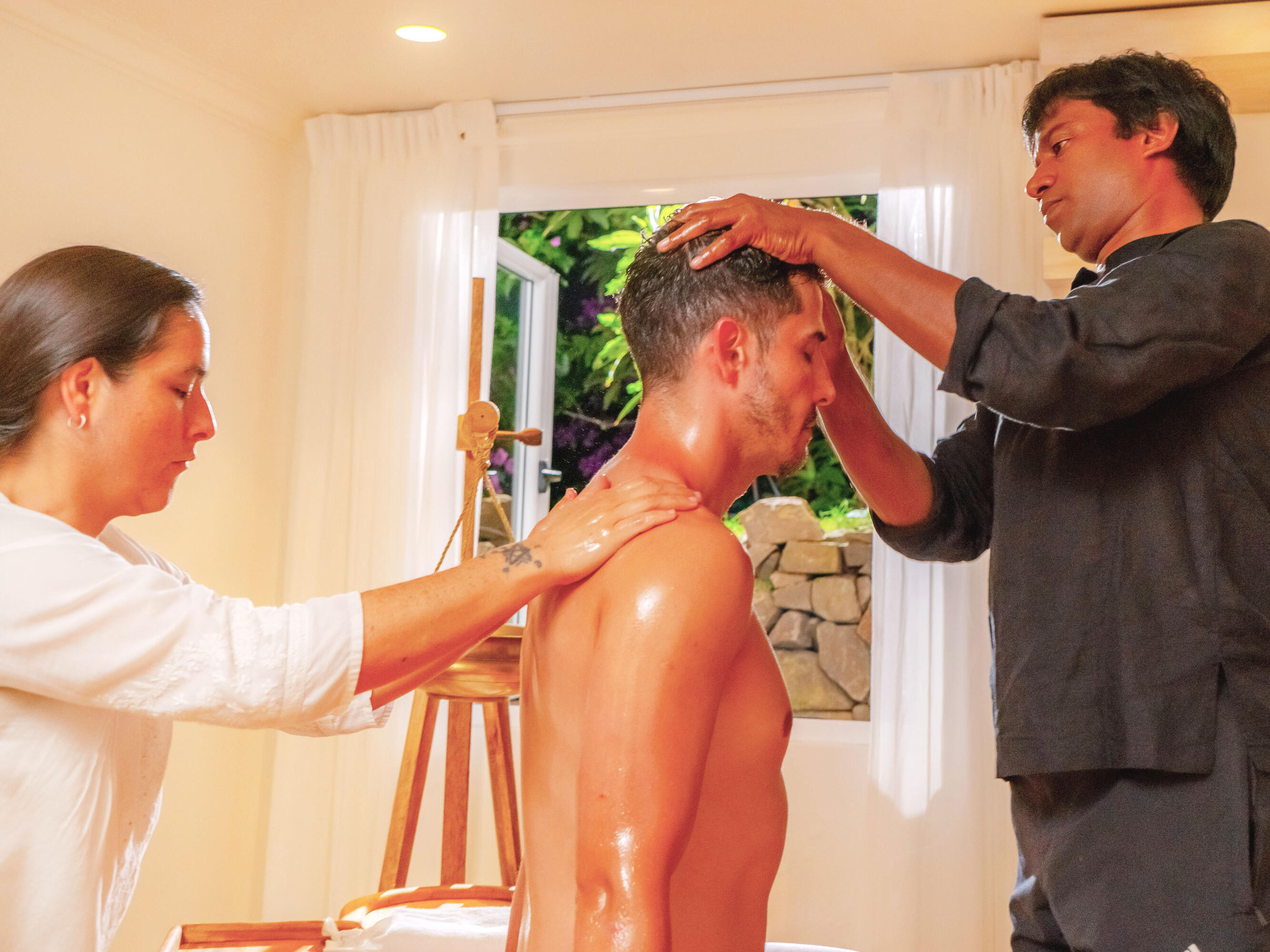 Young man receiving Ayurveda treatment