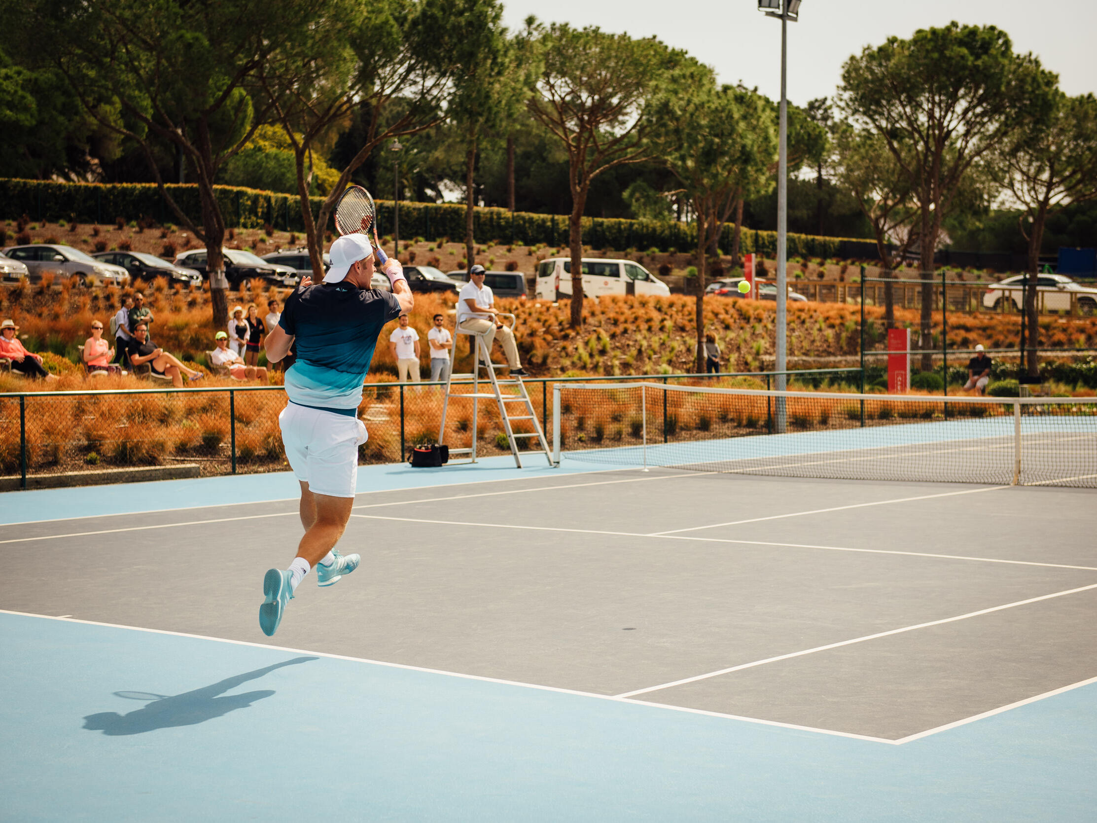 A man playing Tennis-The Magnolia Hotel