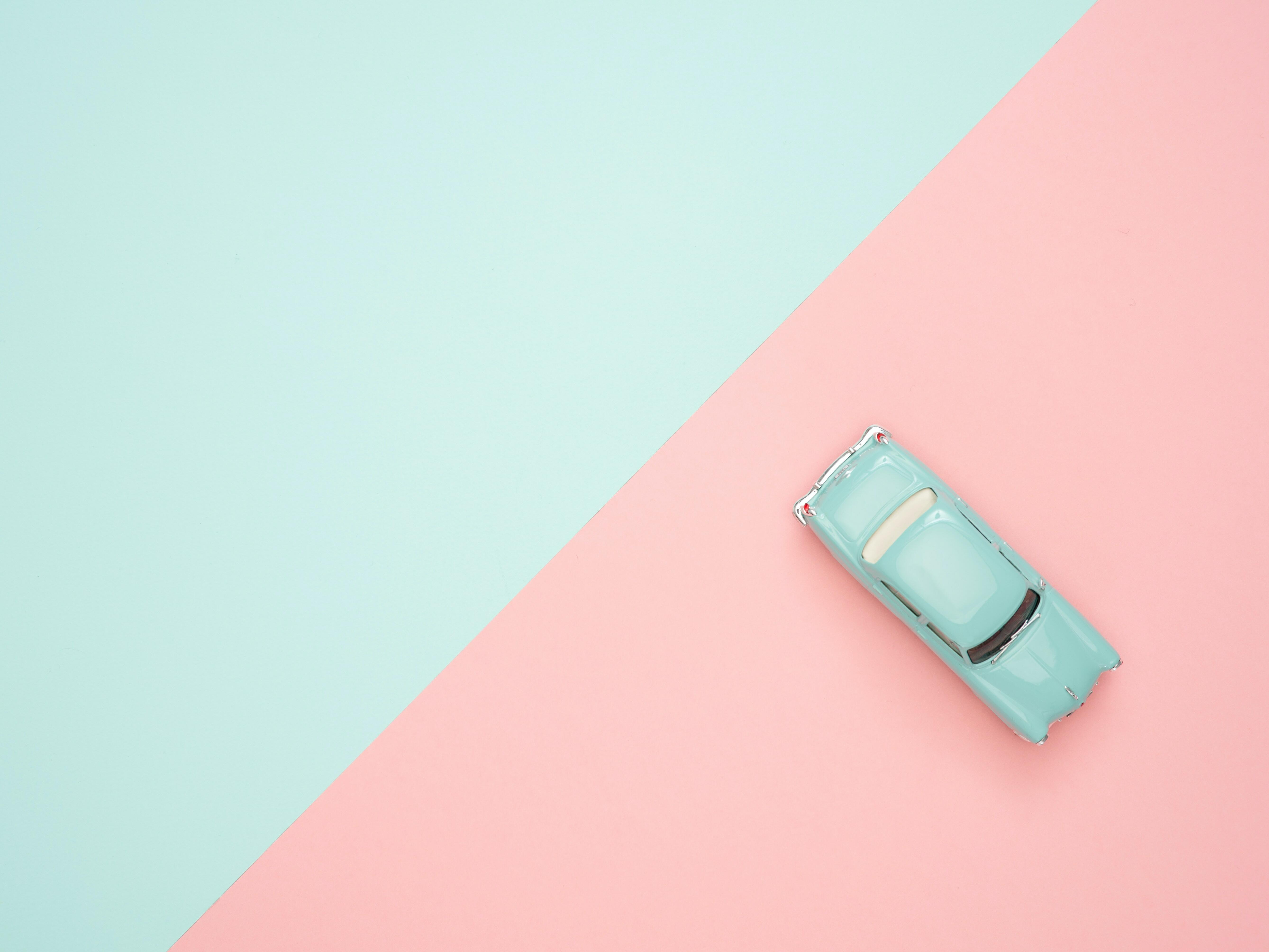 blue car parked in pink and blue spot