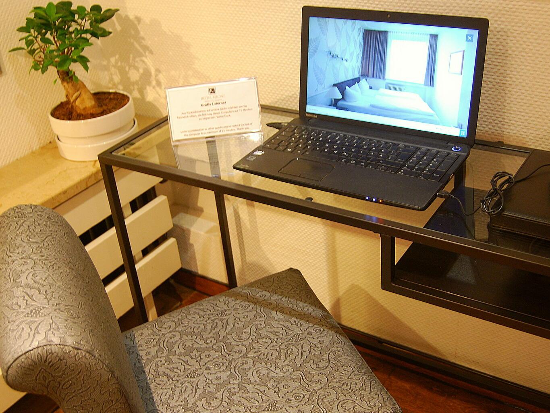 A Laptop on the table - RHK Hotel Krone Aachen