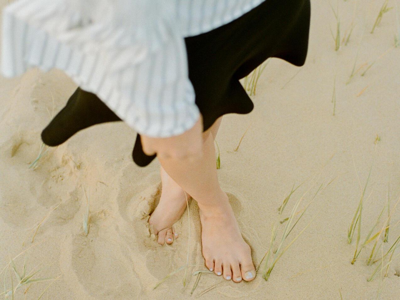 a womans feet on a beach