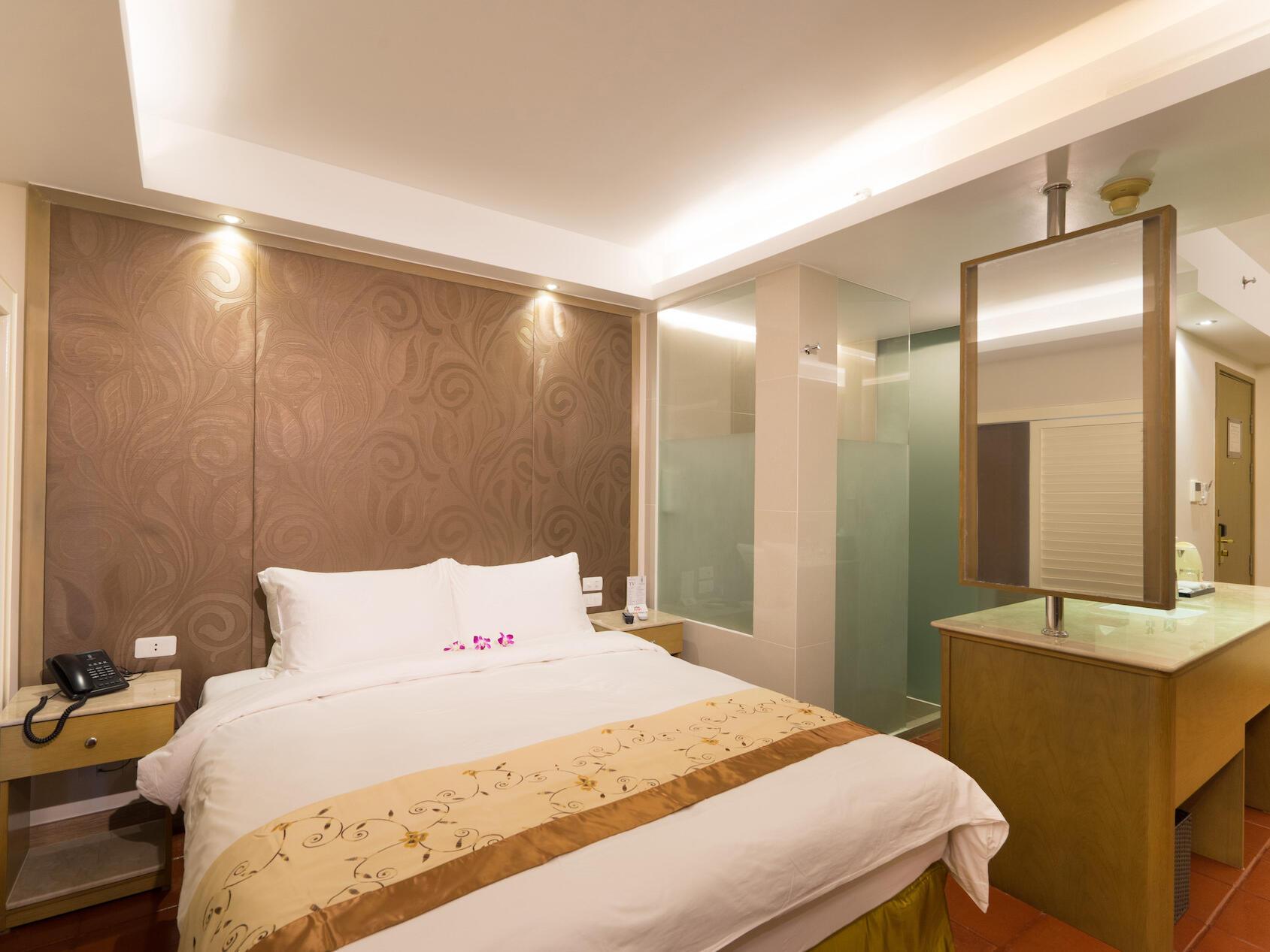 Studio Suite bedroom with mirror  at Empress Hotel Saigon